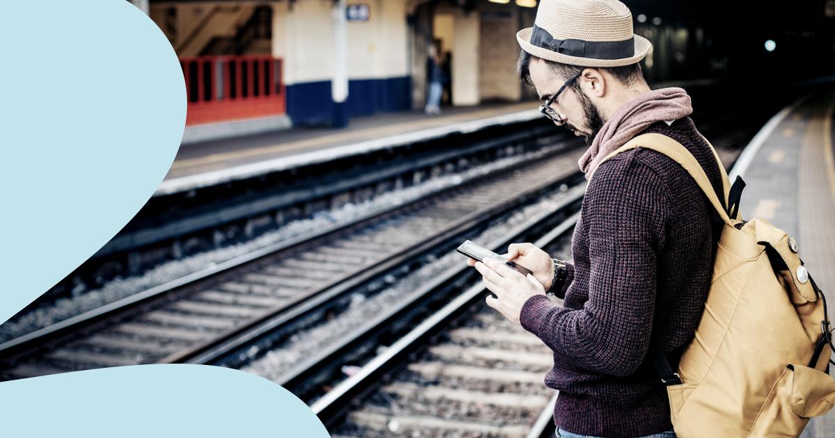 Freelancer saving travel expenses on train platform